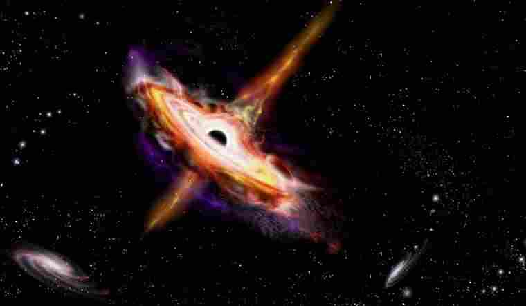 Astronomers discover a dozen quasars heated by a naturally occurring cosmic 'lens'